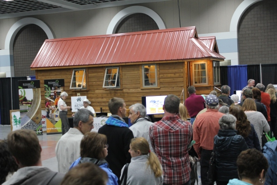 HomeShow attendees fill the River's Edge Convention Center to wait in line to tour the tiny house.